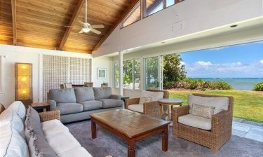 Banyan Estate living room shot with views of the yard and ocean