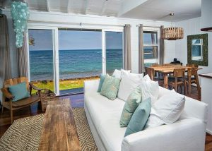 A view from the living room to the beach from The Coral Home, which is near the best Oahu Restaurants