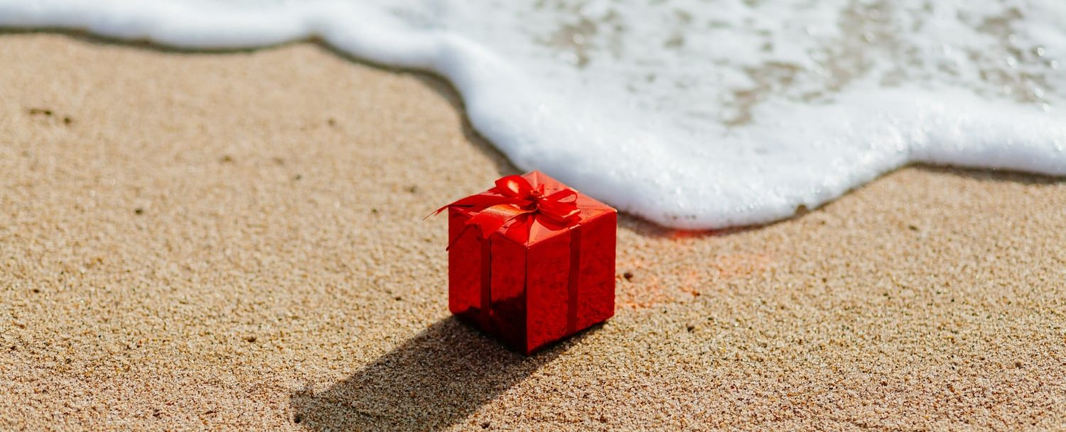 Small red gift on the sand; Things to Do on Oahu in December