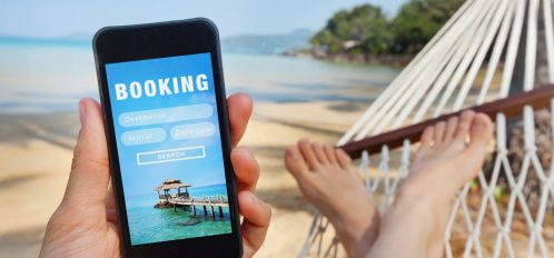 Person in Hammock with Phone Booking a Hawaii Vacation Rental