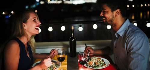 Young couple having dinner on rooftop